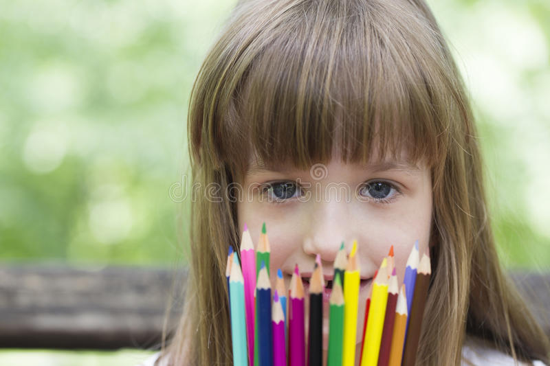 She loves to draw and color with crayons royalty free stock photography