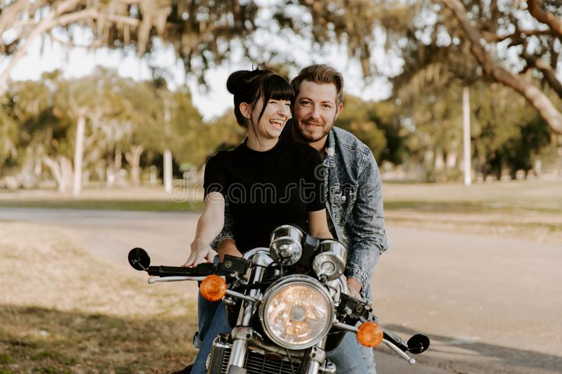 Loving Adorable Portrait of two Attractive Good Looking Young Adult Modern Fashionable People Guy Girl Couple Kissing and Hugging stock photo