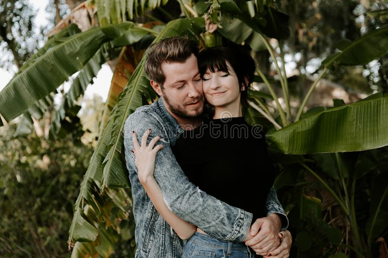 Loving Adorable Portrait of two Attractive Good Looking Young Adult Modern Fashionable People Guy Girl Couple Kissing and Hugging royalty free stock images