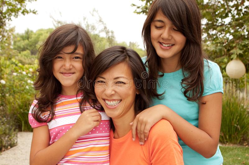 Loving Asian mother and daughter smiling. stock photos