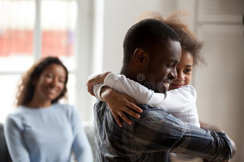 Loving black father embrace little daughter at home. Black African happy family together at home. Close up loving American father strong embrace lovely sweet stock photos