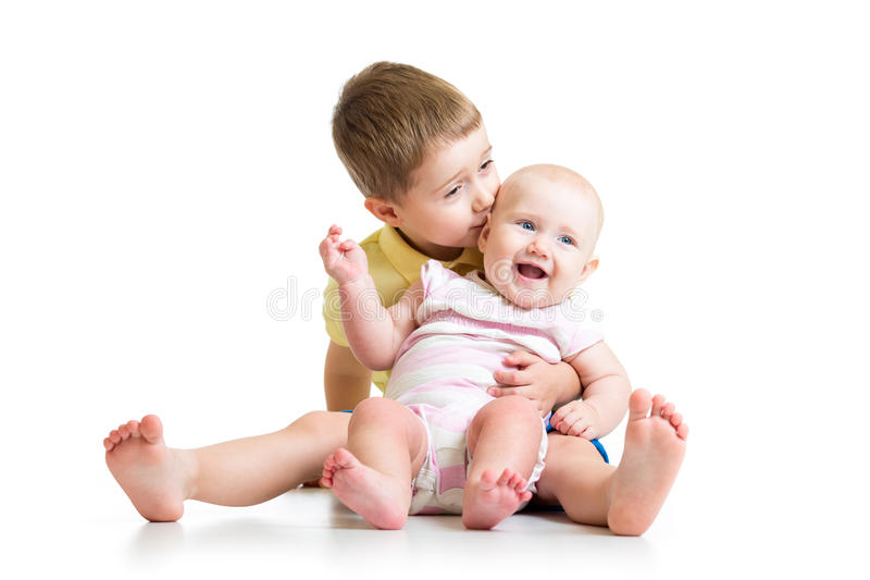 Loving brother kissing baby sister isolated on. White background royalty free stock images