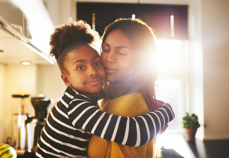 Loving child hugging mother royalty free stock image