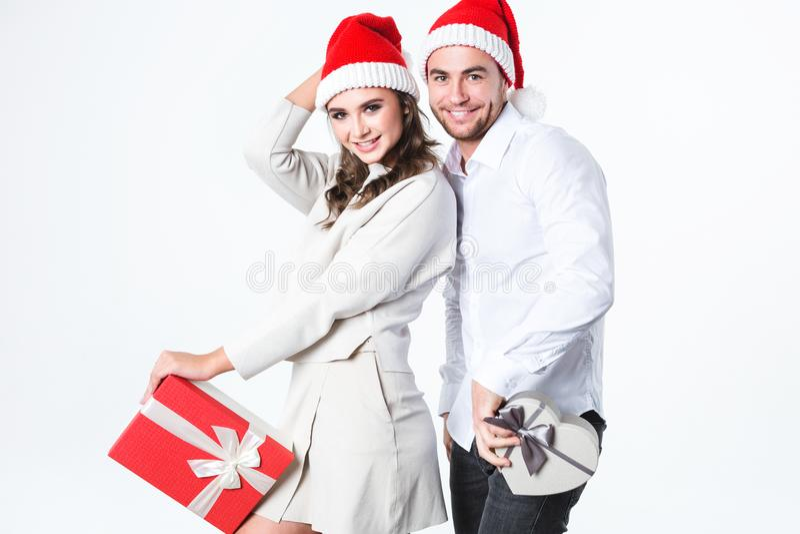 Loving Christmas couple enjoying holidays with gifts. stock photo