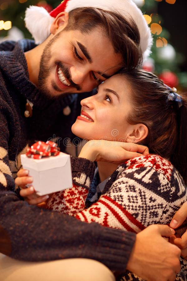 Loving Christmas couple enjoying in the holidays stock images