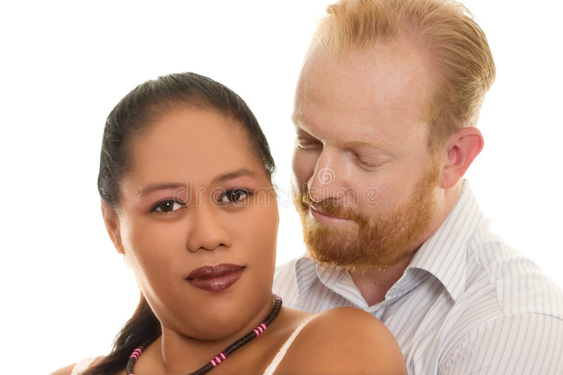 Loving Couple. Loving multicultural diversity couple embrace royalty free stock photo