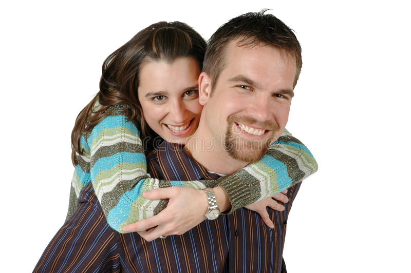 Loving Couple. Husband carries wife on his back. Wife gives hubby a tight squeeze stock photos