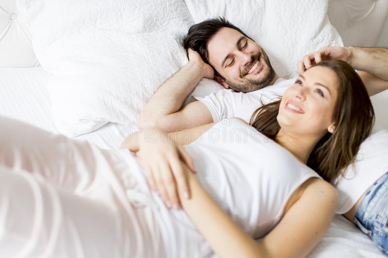 Loving couple in the bed stock images