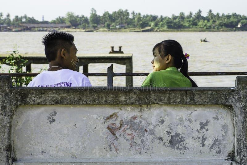 Loving couple on a bench stock photos