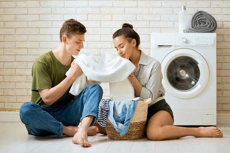 Loving couple is doing laundry stock photos