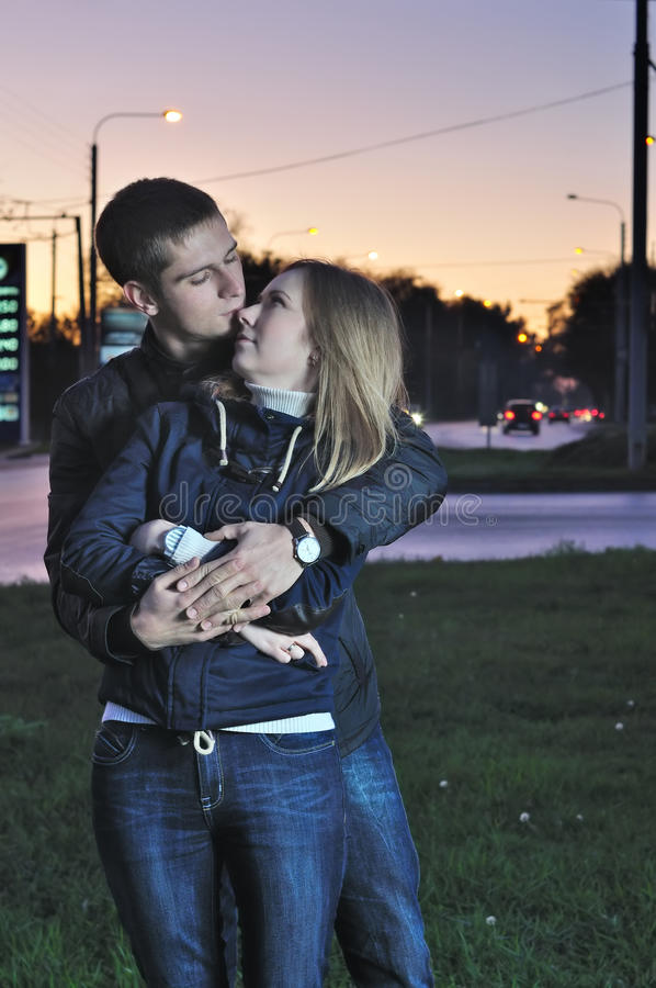 Download Loving Couple Embraces In The Evening Stock Photo - Image: 27006914