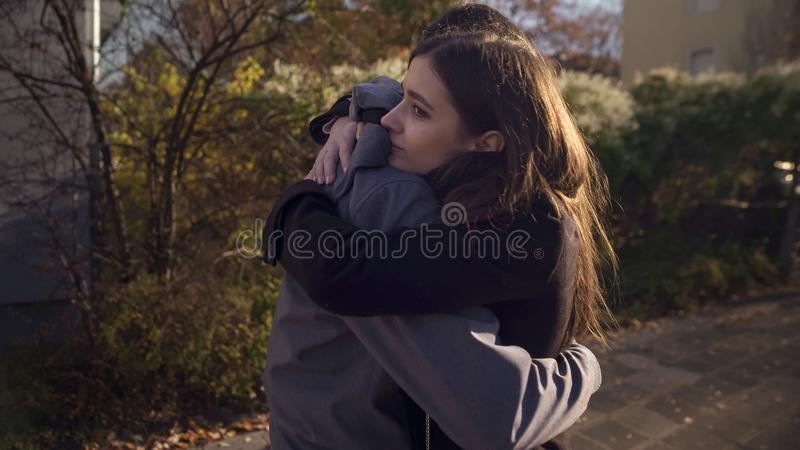 Loving couple embracing outdoors, meeting after long time parting, feeling love royalty free stock photo