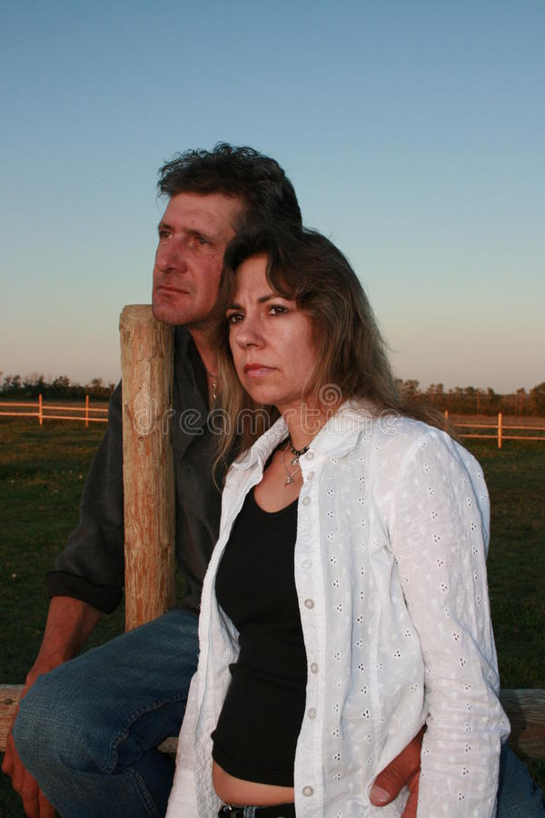 Loving Couple. Enjoying the evening in the country stock image
