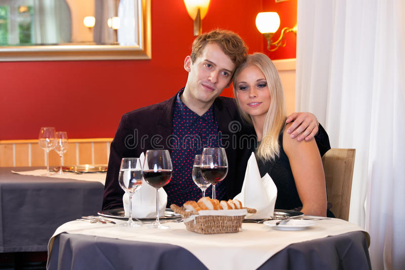 Loving couple enjoying a romantic dinner. royalty free stock photos