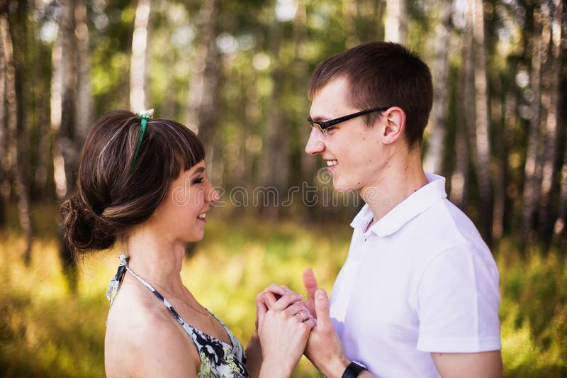 Loving couple in the forest on a sunny day. To love each other royalty free stock photo