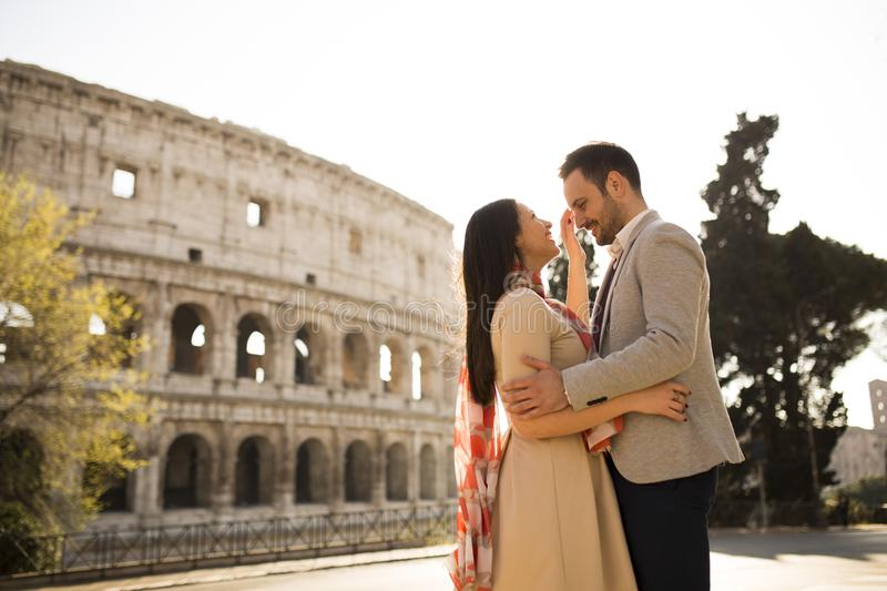 Loving couple in front of the Colosseum in Rome. Loving young couple in front of the Colosseum in Rome, Italy stock image