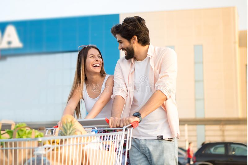 A loving couple in front of the shopping center stock image