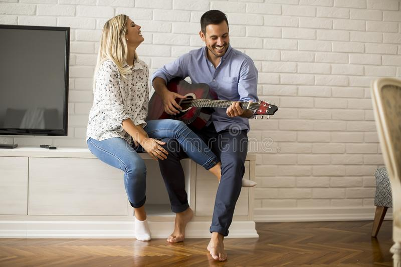 Loving couple with guitar royalty free stock images