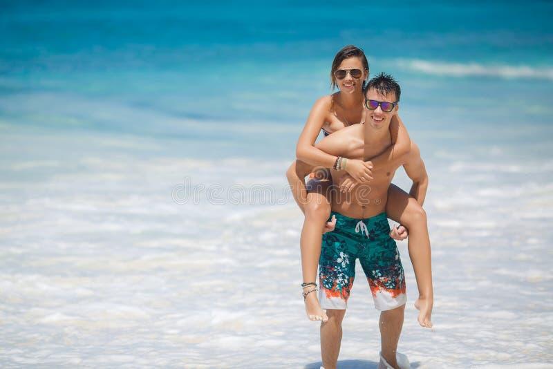 Loving couple having fun on the beach of the ocean. stock photo