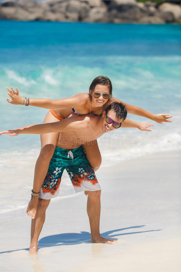 Loving couple having fun on the beach of the ocean. royalty free stock photo