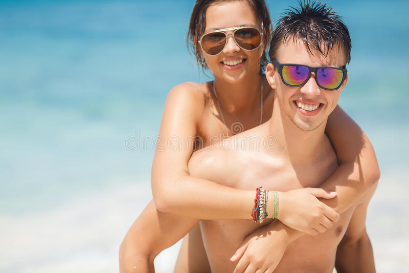 Loving couple having fun on the beach of the ocean. royalty free stock photography
