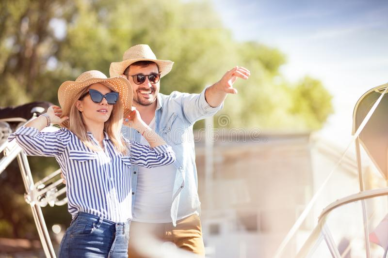 Loving couple having fun together at a yacht club in the summer stock image
