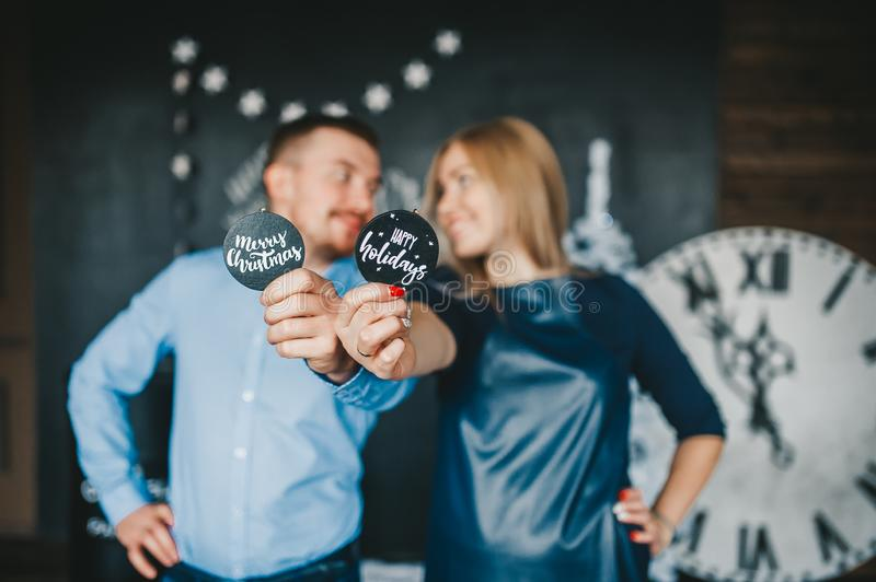 Loving couple holding a wooden round signs stock photos