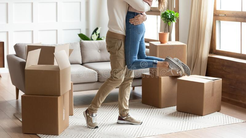 Loving couple hug excited to move together stock images