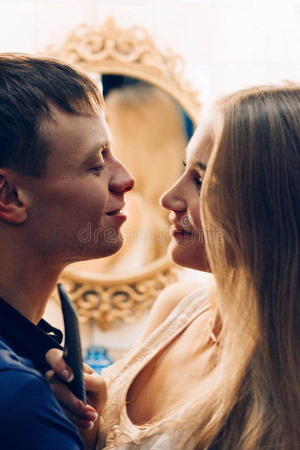 Loving couple hugging in the bathroom mirror. Lifestyle couples stock photography