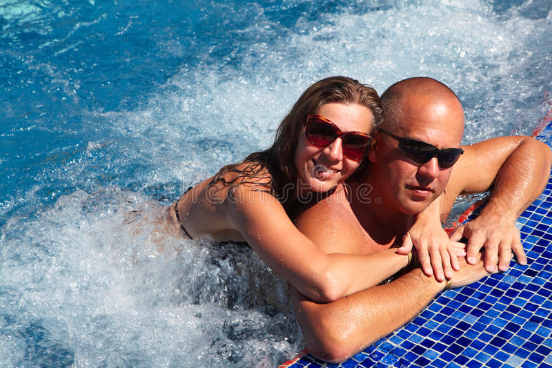 Loving couple in jacuzzi. Loving happy couple in hot-tub. Summer vacation royalty free stock photos