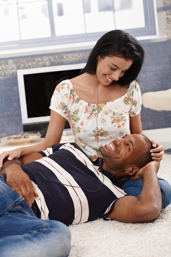 Download Loving Couple Listening To Music At Home Smiling Stock Image - Image: 31218905