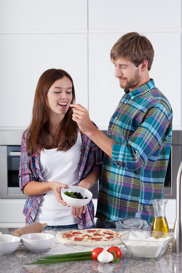 Loving couple made a pizza stock images