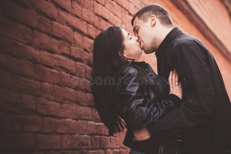 Loving couple near the wall royalty free stock images