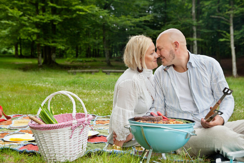 Loving Couple On An Outdoor Picnic royalty free stock image