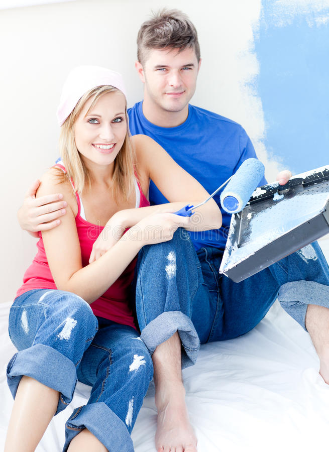 Download Loving Couple Painting A Room Together Stock Photo