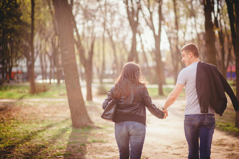 Loving couple in the park royalty free stock photography