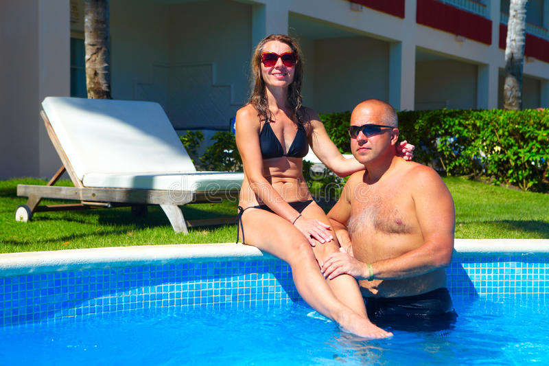 Loving couple in pool. Loving happy couple in pool. Summer vacation royalty free stock photos