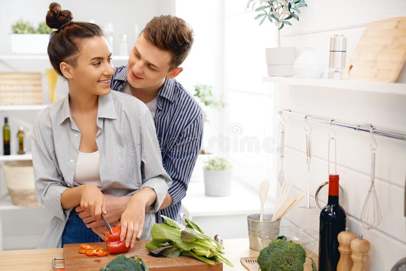 Loving couple is preparing the proper meal stock photography