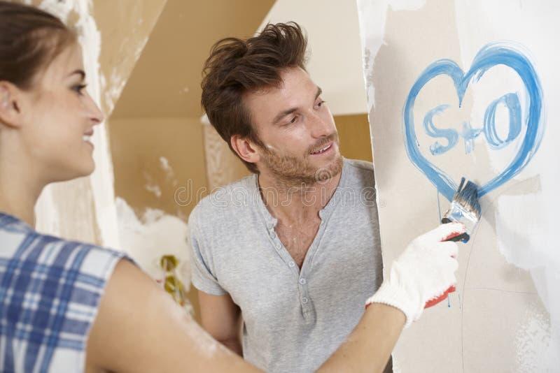 Loving couple renewing home stock photo