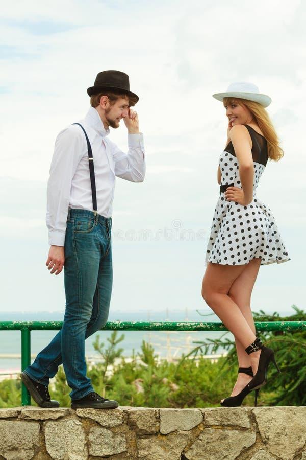 Loving couple retro style flirting outdoor royalty free stock image