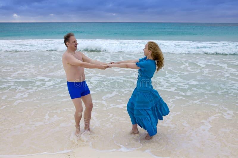 Loving couple on the seashore, Cayo Largo island, Cuba royalty free stock photos