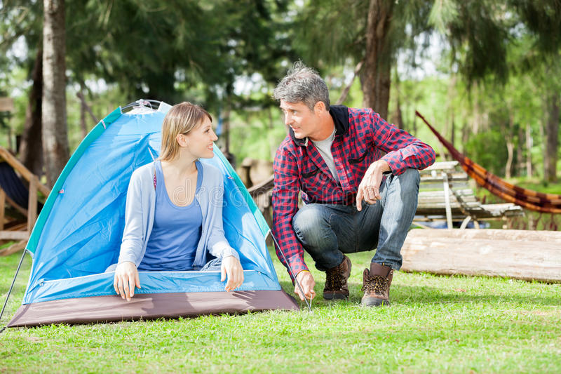 Loving Couple Setting Up Tent In Park stock image