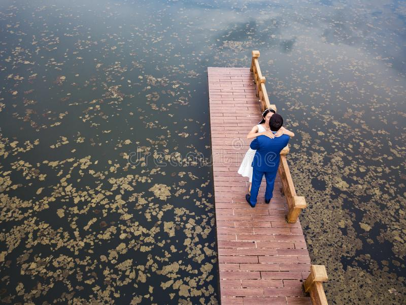 Loving couple on the dock at the lake stock photo