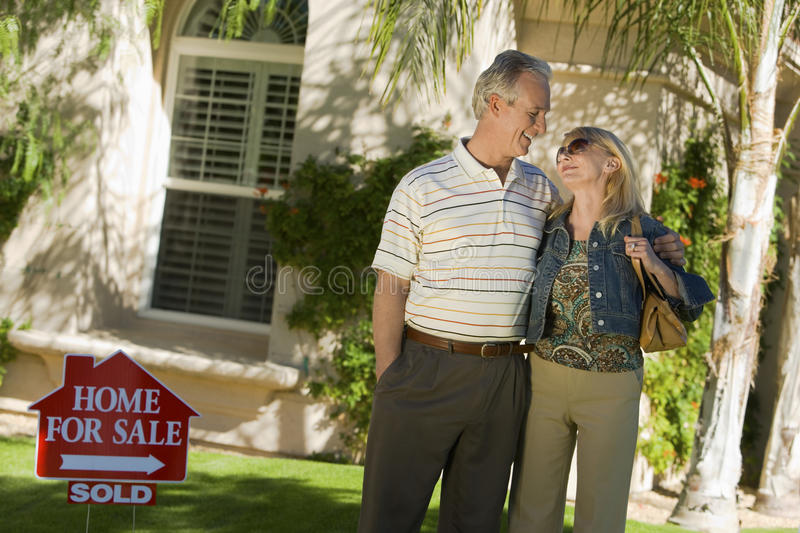 Loving Couple Standing In Front Of House stock photos
