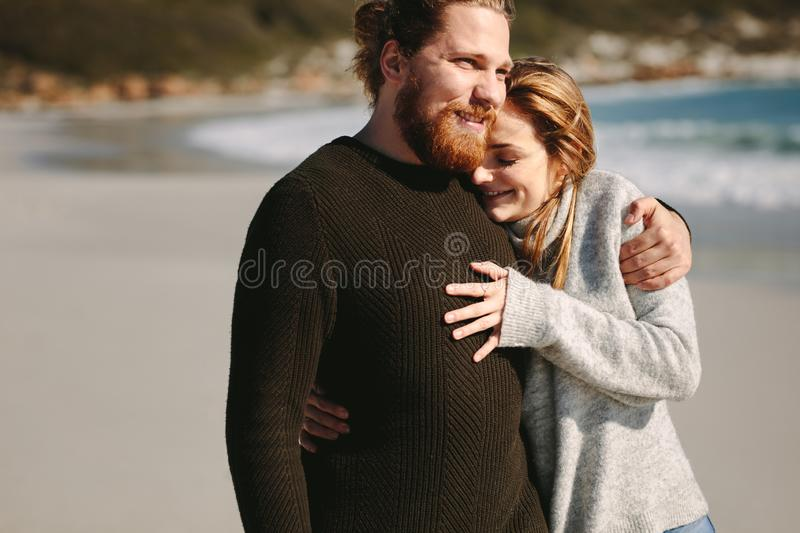 Loving couple standing at the beach royalty free stock images