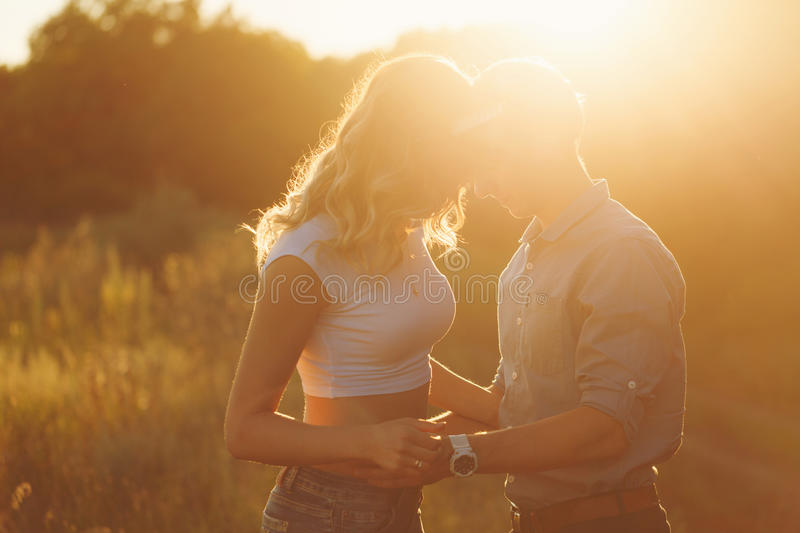 Couple in love at sunset stock images