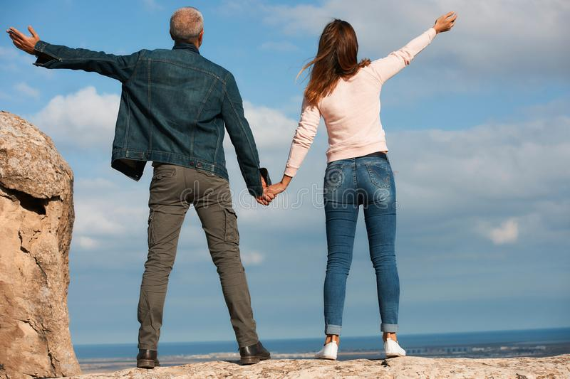 Loving couple travelers hold hands stock image