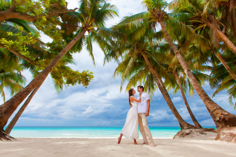 Loving couple on tropical beach with palm trees, wedding o royalty free stock photography
