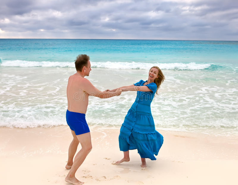 The loving couple is turned on the seashore stock photo