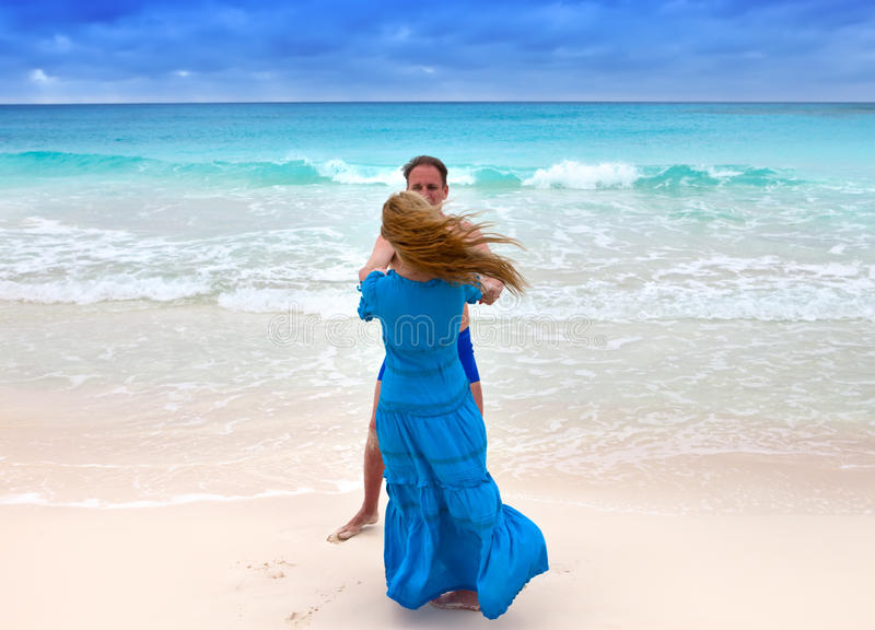 The loving couple is turned on the seashore stock photos